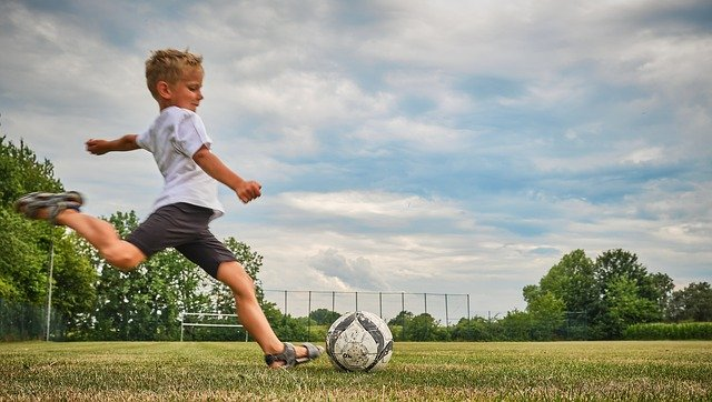 Child kicking ball